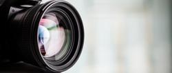 Closeup of a digital camera. Large copyspace