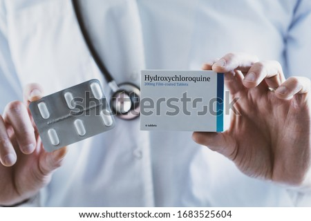 Closeup of a doctor holding Hydroxychloroquine drug