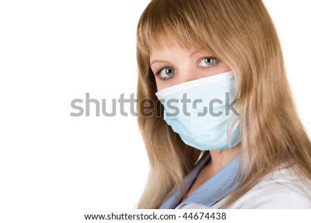 Closeup of a doctor wearing a protection mask - stock photo