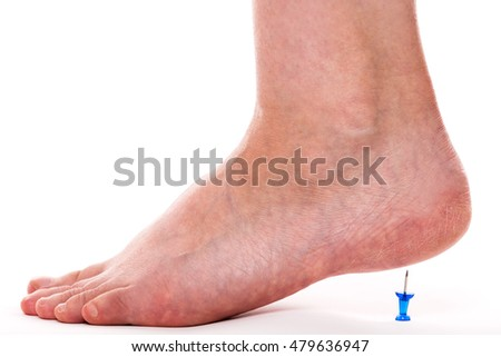 closeup of a female foot with a pin under her heels. concept calcaneal spur or heel spur #479636947