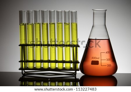 closeup of a flask and a group of test tubes