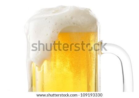 Closeup of a foamy mug of beer