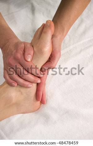 stock photo : closeup of a foot of a natural mature woman having a massage ...