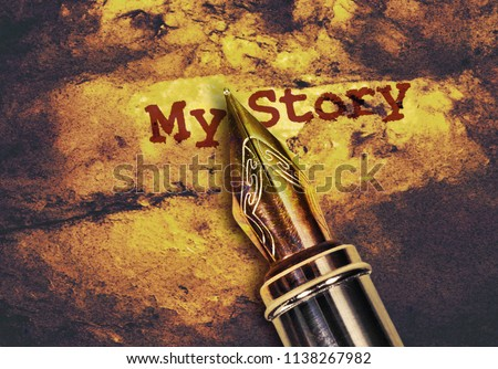 Closeup of a fountain pen and text My Story on golden background
