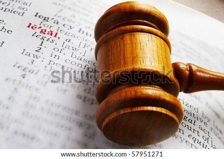 closeup of a gavel and dictionary legal definition