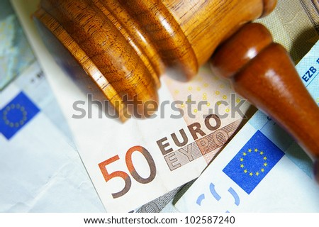 Closeup of a gavel and Euro notes