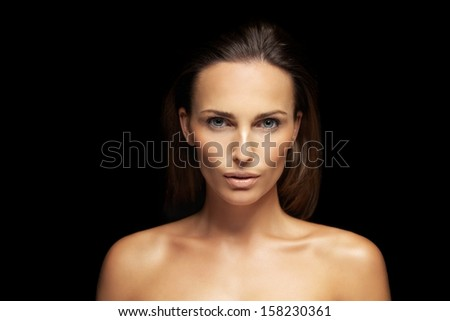 Closeup of a gorgeous young woman with perfect healthy skin isolated on black background. Natural Beauty with fresh and clean skin #158230361