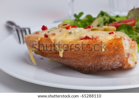 closeup of a grilled cheese baguette