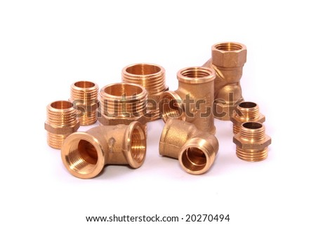 Closeup of a group of copper elbows used in construction