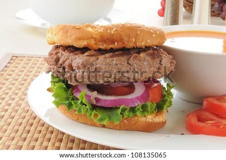 Closeup of a hamburger with tomato soup