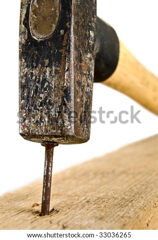 closeup of a hammer hitting the nail,over white background,shallow DOF