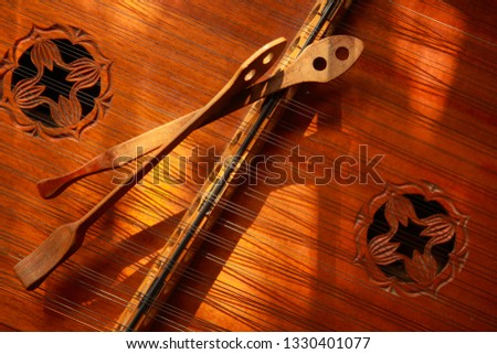 Closeup of a Hammered Dulcimer musical instrument with strings and hammers #1330401077
