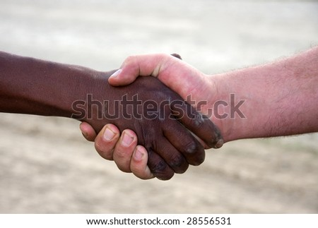 closeup of a hand shake,interracial between black and white. Dusty,dirty hands outdoors, #28556531
