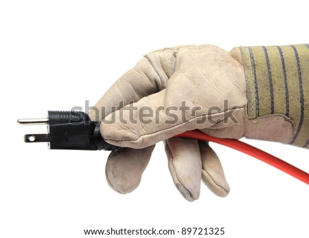 closeup of a hand with glove holding an electric wire