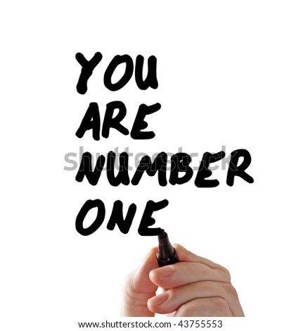 "Closeup of a hand writing a ""you are number one"" message with a marker, isolated on a white background."