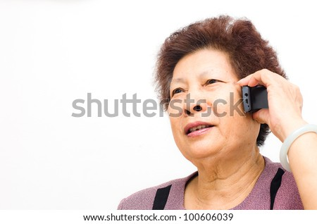 Closeup of a happy senior woman using cellphone over white background