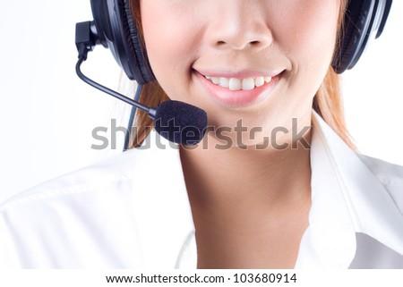 Closeup of a  happy smiling female customer service representative