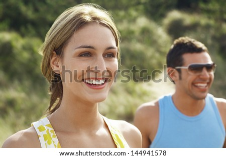 Closeup of a happy young couple at beach