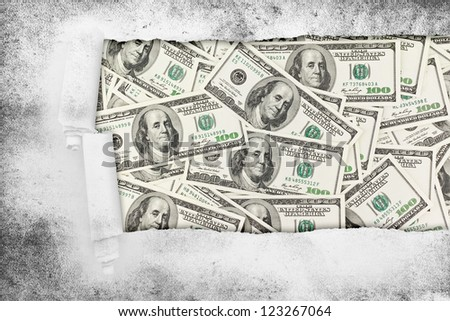 Closeup of a hole in paper over money american hundred dollar bills. Business background