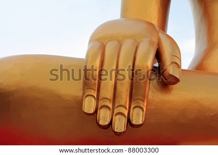 Closeup of a huge hand of the Big Golden color Buddha with gold flakes at Big Buddha Temple in Pattaya, Chonburi province in Thailand