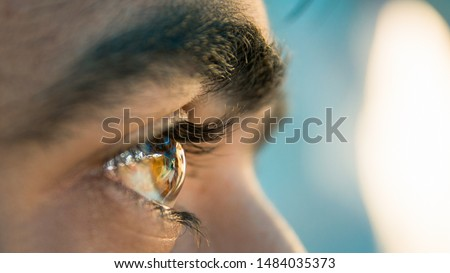 Closeup of a human eye A person looking at front with a eye closeup shot stock photo