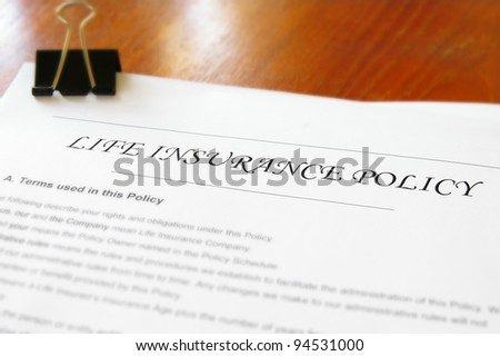 closeup of a life insurance policy on a desk