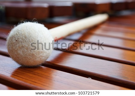 Closeup of a mallet on a wooden marimba #103721579