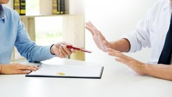 Closeup of a man do not want to Signing Contract or premarital agreement, filling petition form agreement of divorce in office at lawyer desk in court room  Conceptual of marriage.