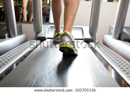 Closeup of a man's legs training in a gym