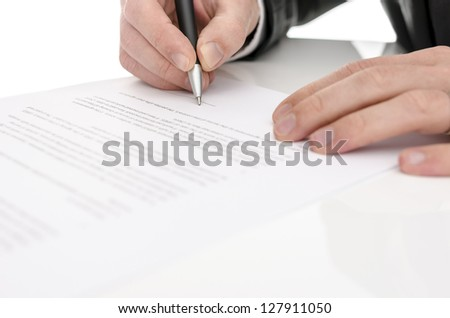 Closeup of a man signing a contract. Selective focus.
