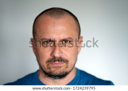 Closeup of a man with black beard and hostile expression Stock foto ©