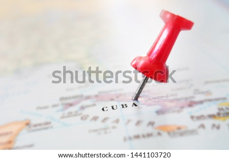 Closeup of a map of Cuba with red thumb tack                                #1441103720