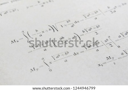 Closeup of a math book and advanced example with integrals
