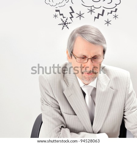 Closeup of a mature angry business man having a stress. Headache. Against white background