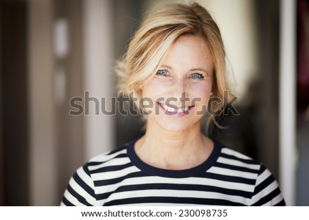 Closeup Of A Mature woman smiling At The Camera