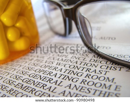 Closeup Of A Medical Hospital Bill, Prescription Medicine And Glasses