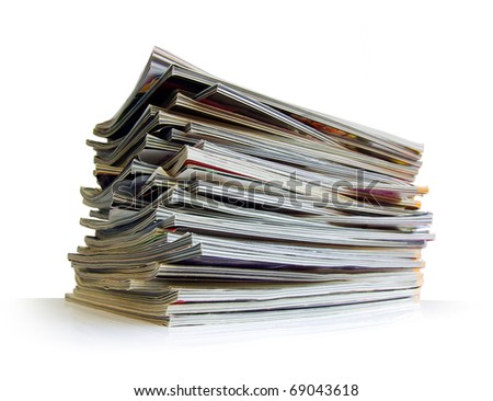 Closeup of a messy pile of old magazines with bending pages