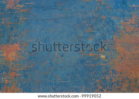 Closeup of a Metal or Steel Plate on the Back of a Truck that is Well Worn and Distressed with Blue Paint that Peeled with Copyspace