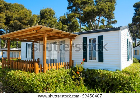 closeup of a mobile home in a campsite on the beach