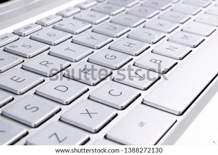 Closeup of a modern silver laptop computer keyboard. Laptop keyboard. Detail of the new and ergonomic computer keyboard.  stock photo
