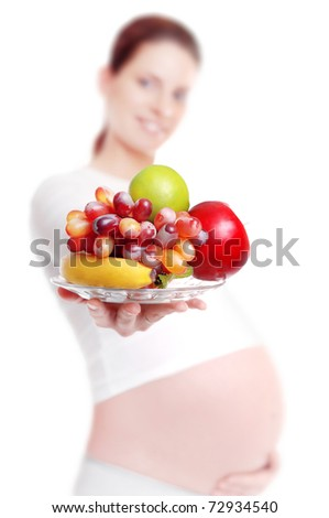 Closeup of a natural food on a blurred pregnant woman background