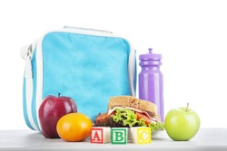 Closeup of a packed school lunch with alphabet blocks. shot in studio