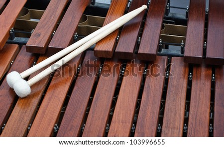 Closeup of a pair of mallets on a wooden marimba #103996655
