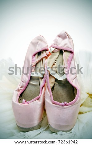 closeup of a pair of pointe shoes and tutu