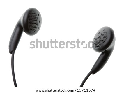 Closeup of a pair of small black headphones isolated against white background with copy space in centre