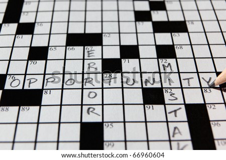 Closeup of a partially completed crossword puzzle with the word opportunity in focus