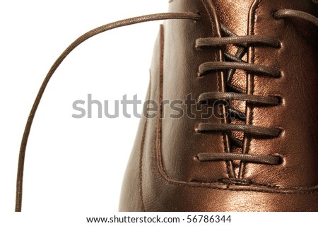 closeup of a patent leather shoe for man isolated on a white background