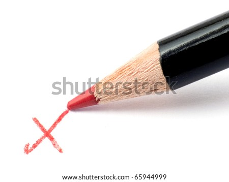 Closeup of a Pencil and checkmark isolated on a white background