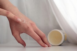Closeup of a person applying vaseline (petroleum jelly).