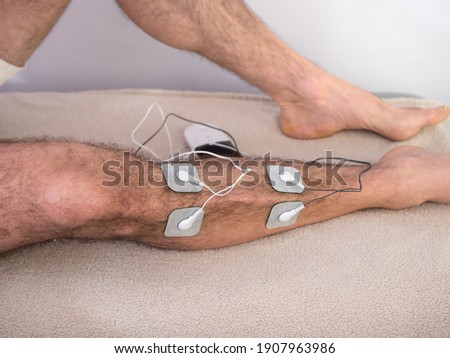 Closeup Of A Person With Electrodes On A Leg Foto stock ©